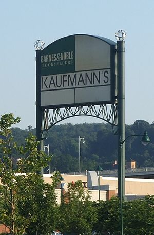 Kaufmann's - Though converted a year prior to this image's creation, this Macy's store located at The Waterfront still had Kaufmann's signage. The current Macy's sign can be seen slightly behind the trees. Macy's has since put a sign over this, but Kaufmann's is still readable beneath.