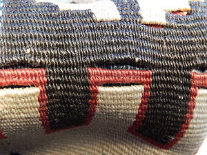 Kilim - Turkish kilim, folded to show slits between different coloured areas