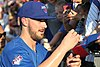 Kris Bryant signing autographs during his rehab assignment against Omaha (29379050837).jpg