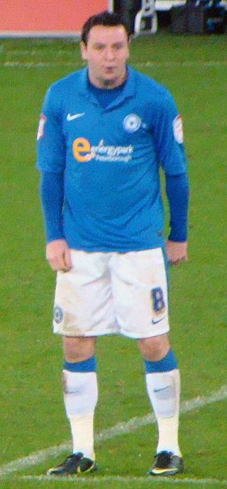 Lee Tomlin - Tomlin playing for Peterborough United in 2012