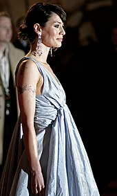 Actress Lena Headey facing right in a silver dress at the London premiere of the film in March 2007