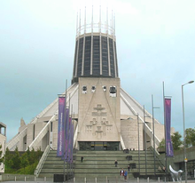 A view from the front the wigwam-shaped cathedral showing steps leading up to the entrance.