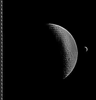 Lunar Orbiter 4 - Image taken by Lunar Orbiter 4, showing the Moon with a crescent Earth in the background. Enhanced by LOIRP.