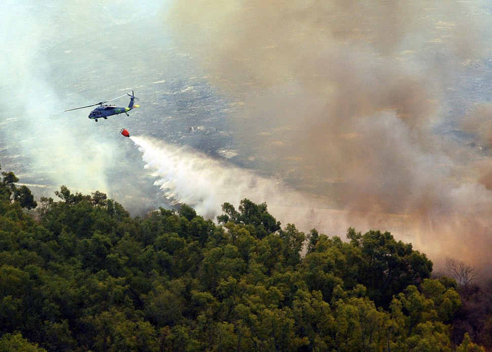 MH-60S Helicopter dumps water onto Fire