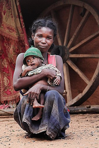 Maternal mortality declined after 1990 but rose sharply after 2009 because of political instability. Madagascar woman with child.jpg