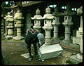 Man beginning to carve lantern from block of stone. (19942572782).jpg
