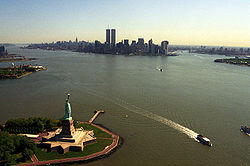 The iconic view of New York City showing many of its major landmarks, including the Statue of Liberty, Ellis Island, Empire State Building, and World Trade Center, July 2001.