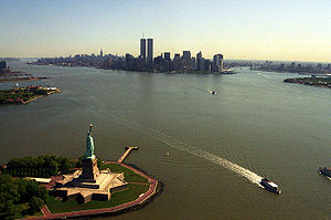 The iconic view of New York City showing most of its major landmarks, including the Statue of Liberty, Ellis Island, Empire State Building, and World Trade Center, May 2001