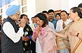 Manmohan Singh and the Chairperson, National Advisory Council, Smt. Sonia Gandhi offering condolence to the family members on the demise of the former Chief Minister of Arunachal Pradesh, Shri Dorjee Khandu, in Itanagar.jpg