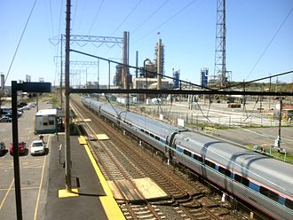 Marcus Hook station - An Amtrak train crosses through the Marcus Hook station, heading south towards Delaware as seen from the overpass on PA452 in April 2012.