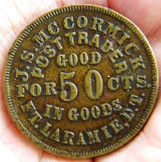 Truck wages - Brass trade token from Fort Laramie, Dakota Territory, used in a truck system