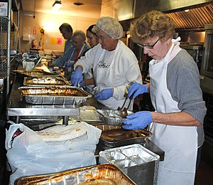 Hunger in the United States - Volunteers preparing meals for Meals on Wheels recipients