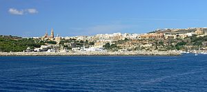 Garzes Tower - View of Mġarr from the sea, with the site of Garzes Tower on the right