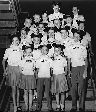 The Mickey Mouse Club - 1956 cast photo. Front row; L–R: Annette Funicello, Karen Pendleton, Cubby O'Brien, Sherry Alberoni, Dennis Day. Row two: Charley Laney, Sharon Baird, Darlene Gillespie, Jay-Jay Solari. Row three: Tommy Cole, Cheryl Holdridge, Larry Larsen, Eileen Diamond. Row four: Lonnie Burr, Margene Storey, Doreen Tracey. Back row: Jimmie Dodd, Bobby Burgess.