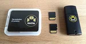 MintChip - A pair of MintChips (centre) and accessories from the Mint.