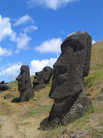 Three moai in various states of repose