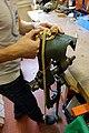 Mobilier national - Atelier bronze et lustres - Démonstration de retrait du feu de forge 09.jpg