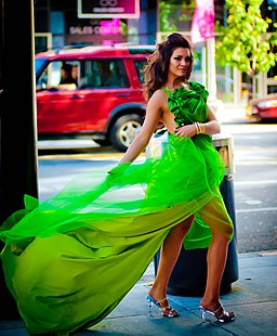 Model Kim Kilgrove's stunning green dress blows in the wind