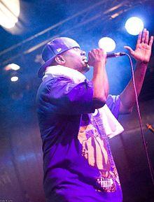 Modenine performing on stage.jpg