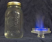 Moonshine, it was incorrectly assumed that the blue flame means it may be safe to drink.