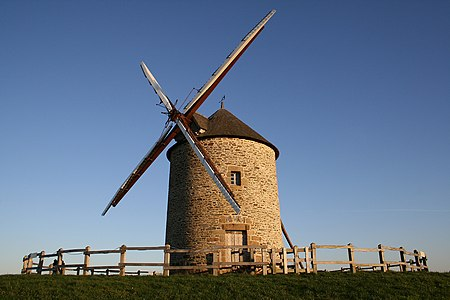 Windmill of Moidrey, in Normandy, France. The windmill is located of top of a hill which offers panoramic view over the Mont Saint-Michel bay.