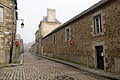Mur d'enceinte de l'ancien couvent des Bénédictines dans la rue de Lehon, Dinan, France.jpg
