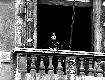 Mussolini delivering his declaration of war speech, from the balcony of the Palazzo Venezia in Rome Mussolini DOW 10 June 1940.jpg