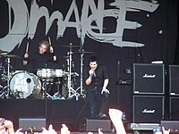 My Chemical Romance, dressed in black, onstage