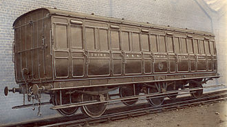 Tumblehome - Tumblehome can be seen where the carriage body attaches to the underframe in this photo of a North British Railway 3rd Class carriage from around 1900