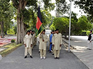 Afghanistan Scout Association - The Nangarhar Cub Scouts march toward the governor's palace before a transfer of responsibility of the Nangarhar Scout program ceremony in October 2010.
