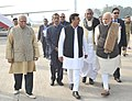 Narendra Modi being welcomed by the Governor of Uttar Pradesh, Shri Ram Naik and the Chief Minister of Uttar Pradesh, Shri Akhilesh Yadav, on his arrival, at Lucknow airport, in Uttar Pradesh on January 22, 2016.jpg