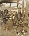 Nez Perce couple and child on exhibit - A-Y-P - 1909.jpg