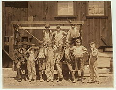Noon hour. These boys are all working in the Illinois Glass Co.jpg
