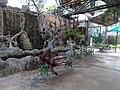 Orangutan on bench - panoramio.jpg