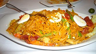 Pancit - Pancit luglug topped with hardboiled eggs, shrimp, and chorizo.