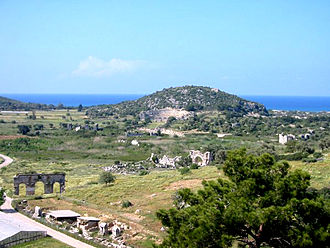 Patara, Lycia - A picture of some of the ruins in Patara. Note a city gate at the lower left corner and the theatre set on the hillside.