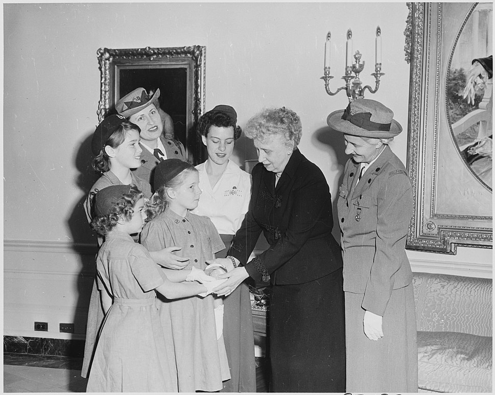 Photograph of First Lady Bess Truman at the White House with a delegation of Girl Scouts, who are presenting her with... - NARA - 200404