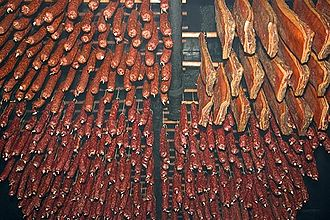Smoking (cooking) - Meat hanging inside a smokehouse in Switzerland