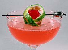 Pink Lady with a twist of lime, in a cocktail glass.jpg
