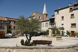 The village square with a fountain, in Saint-Didier