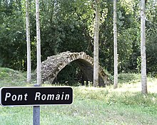 "Photo-montage of a medieval bridge and a road sign with the erroneous entry ""Roman bridge"""