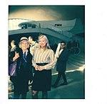 Portrait of costumed and actual frilght attendants inside the JFK flight center.jpg