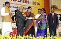 Pranab Mukherjee presenting the National Award for Teachers-2014 to Smt. Palaparthi Krishnaveni, Andhra Pradesh, on the occasion of the 'Teachers Day', in New Delhi. The Union Minister for Human Resource Development.jpg