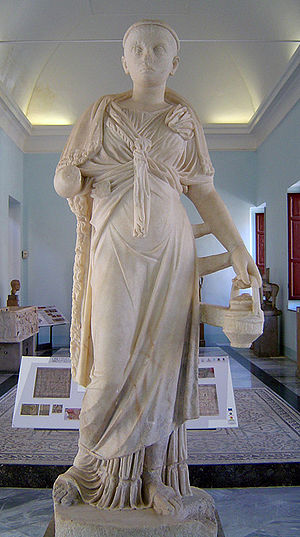 Mysteries of Isis - Priestess of the Egyptian goddess Isis, holding a situla (a bronze jug); Roman sculpture of the 2nd century CE, on display at the Regional Archeological Museum Antonio Salinas, Palermo, Sicily