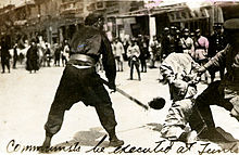 Public beheading of a communist during Shanghai massacre of 1927.jpg
