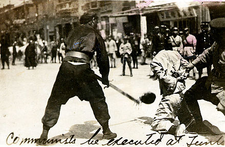 Public beheading of a communist by the Kuomintang. Public beheading of a communist during Shanghai massacre of 1927.jpg