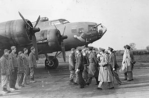 "RAF Chelveston - King George VI passes a B-17 Flying Fortress (AAF Serial Number 41-24352) nicknamed ""Holey Joe"" as he meets personnel of the 301st Bomb Group during a royal visit to Chelveston 14 November 1942."