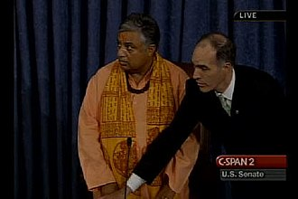 "Rajan Zed prayer protest - Senator Bob Casey as the Presiding Officer of the Senate directs that ""The Sergeant-at-Arms will restore order in the Senate"" as Christian protestors interrupt Guest Chaplain Rajan Zed on July 12, 2007"