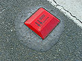 Red raised pavement marker.jpg