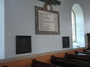 Filleigh - Two small monumental brasses formerly affixed to the now lost tomb-monument of Richard Fortescue (died 1570) of Filleigh, displaced from their original location in the pre-1732 old church. Now affixed in Victorian frames to north wall of nave of new post-1732 Church of St Paul, Filleigh. To the left the brass depicts Sir Bernard Drake (died 1586), who erected the now lost monument to his brother-in-law Richard Fortescue (died 1570) who is depicted in the brass on the right. Above is a marble mural monument listing members of the Fortescue family buried in the family vault below